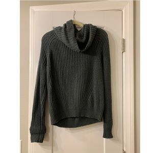 Turtle neck sweater.
